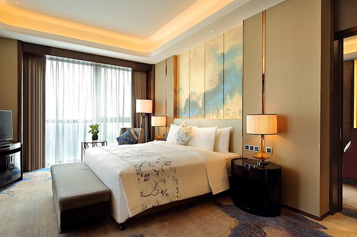 内江万达嘉华酒店豪华套房卧室